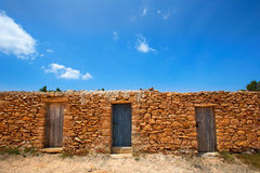 Formentera Cala Saona beach masonry fishermen houses Royalty Free Stock Images