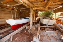 Formentera Cala Saona beach rail beached boats Stock Image