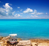 Formentera Es Ram beach with traditional boat Stock Images
