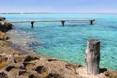 Formentera Illetes turquoise sea wooden pier Stock Photos