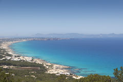 Formentera. Island, Spain. View on northern rocky coastline. On the horizon is Es Vedra Stock Images