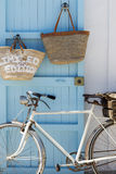 Formentera. Old bicycle leaning against blue door Royalty Free Stock Image