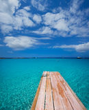 Formentera Ses Illetes beach pier Illetas and Ibiza Royalty Free Stock Photo