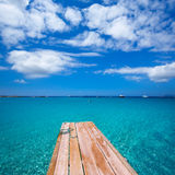 Formentera Ses Illetes beach pier Illetas and Ibiza. Formentera Ses Illetes beach pier Illetas with Ibiza background at balearic islands Royalty Free Stock Photos