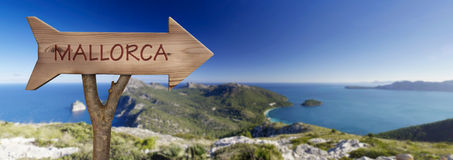 Formentor Cape in majorca, balearic islands. Trunk and wooden sign indicating to mallorca Stock Photo