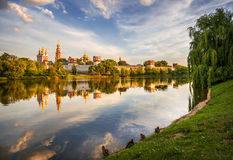 Former beauty of the Novodevichy Convent. Novodevichy Convent at sunset with reflection in the lake and the ducks on the shore Stock Images