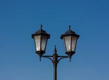 Former Black Lantern. Black street lantern against the blue sky Stock Images
