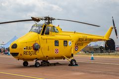 Former British Royal Air Force (RAF) Westland WS-55 Whirlwind rescue helicopter on the tarmac. FAIRFORD, UK - JUL 13, 2018: Former British Royal Air Force ( stock photo