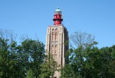 Former church-tower is now functioning as lighthouse. Netherlands,Holland,Dutch,Zeeland,Westkapelle,july 2017 royalty free stock photography