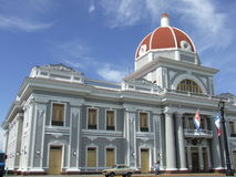 Former Cienfuegos province Council building. With flags, Cuba Royalty Free Stock Photo