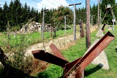 Former communism iron curtain in Bucina, National Park Sumava in the Czech Republic. Memory of deadly barrier on frontier crossing. With Germany royalty free stock photography