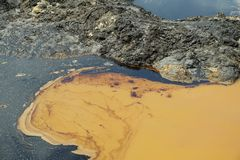 Former dump toxic waste, effects nature from contaminated soil and water with chemicals and oil, environmental disaster stock photos