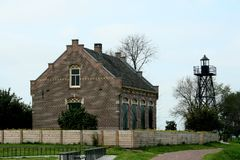 Former dwelling of the lighthouse keeper on the former island of Schokland. Netherlands,Flevoland,Noordoostpolder,Schokland,december2016: Former dwelling of the royalty free stock photography
