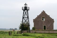 Former dwelling of the lighthouse keeper on the former island of Schokland. Netherlands,Flevoland,Noordoostpolder,Schokland,december2016: Former dwelling of the royalty free stock images