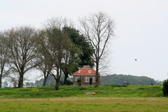 Former dwelling of the lighthouse keeper on the former island of Schokland. Netherlands,Flevoland,Noordoostpolder,Schokland,december2016: Former dwelling of the stock images