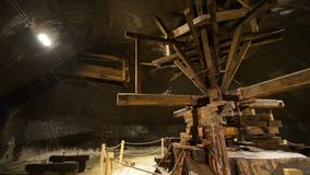Former Extraction Machine driven by horses. Old traditional extraction machine driven by horses, called Crivac in a salt mine gallery in Turda, Transylvania stock video footage