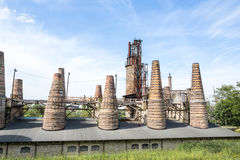 Former factory tiles and bricks tall chimneys Royalty Free Stock Images