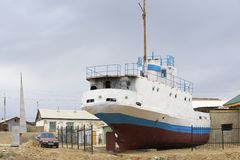 Former fishing boat lays onshore Aralsk, Kazakhstan. Stock Photography