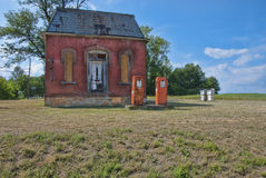 Former gas station. Old gas tanks in front of this antique building is much nicer than our modern service stations. Photo for antique lovers Stock Image