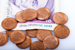 Former german Currency, 10 Mark Banknote and Pfennig Stock Photography
