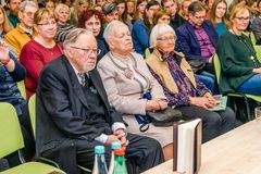 Former Head of State Vytautas Lansbergis, the father of the book writer, is sitting in the first row with his wife at the Vilnius stock photo