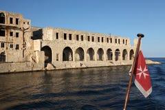Former Lazzaretto Isolation hospital and Maltese flag Stock Image