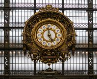 The former Lyon station in Paris, and now the Museum D, orsay, impresses with its architecture and pompous clock. stock photography