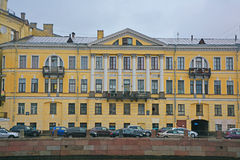 Former Mizhuyev's house in style classicism on Fontanka River in Saint Petersburg, Russia. Old mansion on Fontanka River embankment in the centre of Saint Stock Photos