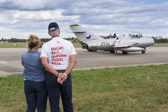 Former owner, collector Tom Smith looking at jet fighter aircraft Mikoyan-Gurevich MiG-15 standing on runway on September 5, 2015 Royalty Free Stock Photography