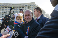 Former Romanian president Traian Basescu and his granddaughter Royalty Free Stock Photo