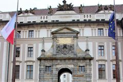 Prague, Czech Republic, January 2015. Former royal and now presidential palace and flags of the Czech Republic and the European Un royalty free stock photos