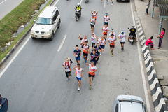 Former Thai national athlete run 750 km, from Bangkok to Phayao. Pathumthani Thailand - July 30 : Top view of `KruDin` Sathavorn Chanpongsri Former Thai national stock photos