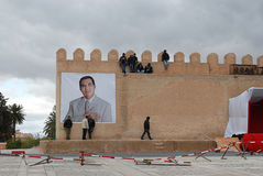 Former Tunisian President Ben Ali in Kairouan. A big poster of former Tunisian President Ben Ali displayed in the walls of  the city of Kairouan during one of Royalty Free Stock Photos