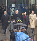 Former U.S. President Bill Clinton emerges from the library with President George W. Bush, former presidents Jimmy Carter and Geor Stock Photos