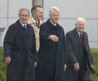 Former U.S. President Bill Clinton waves from the stage accompanied by President George W. Bush, former presidents Jimmy Carter an Stock Images