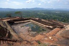 The former water tank on the summit of Sigiriya Rock in Sigiriya in Sri Lanka. Stock Photography