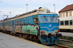 Former Yugoslav railways electric locomotive with graffiti Belgrade station Serbia. Belgrade, Serbia - March 19, 2015: A blue liveried electric railway engine of Royalty Free Stock Photo