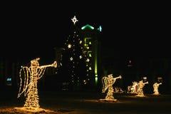 Formes des anges avec la trompette dans le temps de Noël Photo libre de droits