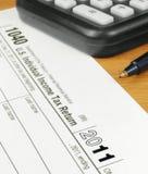 Formi la dichiarazione dei redditi specifica dei 1040 Stati Uniti per 2011 Fotografia Stock Libera da Diritti