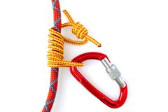 Forming an Autoblock knot also called Machard or French Prusik with a 5mm accessory cord around a 9.8mm climbing rope. Knot is finished when the carabiner royalty free stock photos