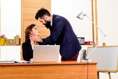 Forming close bonds with workmate. Workplace affair. Boss and secretary having sweet affair. Love affair of bearded man. Forming close bonds with workmate stock photo