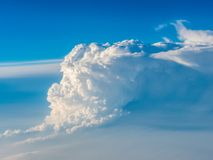 Forming cumulonimbus clouds. Seen from the airplane Stock Image