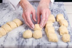 Forming Dinner Rolls Royalty Free Stock Images