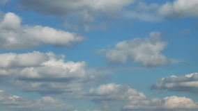 Forming puffy clouds dramatic sky fast motion picturesque day time-lapse stock footage