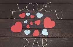 Forming the word: i love DAD on wooden background stock photo