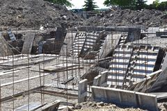 Placing forms  and rebar to create a house foundation,. Forms are being set at basement level needed to create a foundation for a new house royalty free stock image