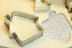 Forms for the cookies, rolling pin and dough Stock Image