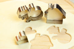 Forms for the cookies, rolling pin and dough Royalty Free Stock Image