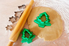 Forms for the cookies, rolling pin and dough Stock Photography