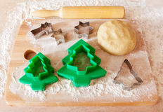 Forms for the cookies, rolling pin and dough Stock Photos